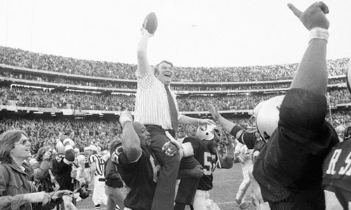 John Madden Holding the Ball High